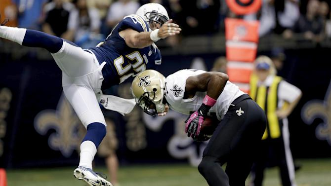 New Orleans Saints wide receiver Marques Colston (12) pulls in a touchdown reception in front of San Diego Chargers free safety Eric Weddle (32) in the second half of an NFL football game at Mercedes-Benz Superdome in New Orleans, Sunday, Oct. 7, 2012. (AP Photo/Dave Martin)