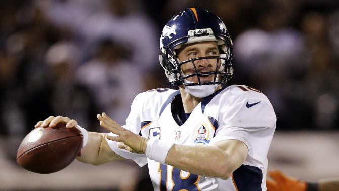 Denver Broncos quarterback Peyton Manning throws against the Oakland Raiders during the second quarter of an NFL football game in Oakland, Calif., Thursday, Dec. 6, 2012. The Broncos won 26-13. (AP Photo/Marcio Jose Sanchez)