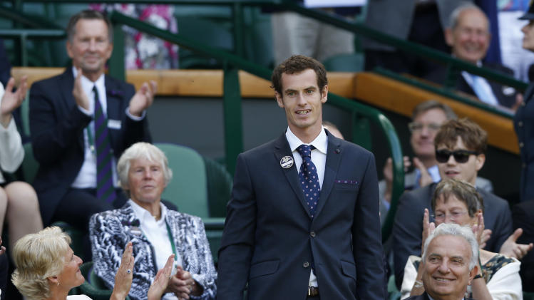 Britain's Andy Murray of Britain arrives to take his seat on Centre Court at the All England Lawn Tennis Championships in Wimbledon, London, Saturday, June 29, 2013. (AP Photo/Sang Tan)