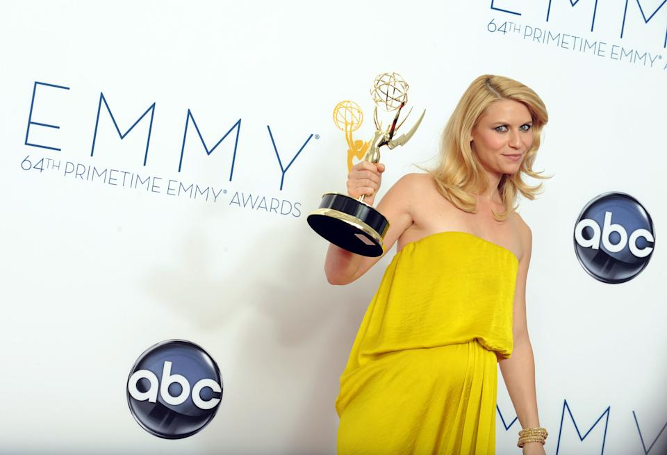 "Actress Claire Danes, winner of the Outstanding Lead Actress In A Drama Series award for ""Homeland,"" poses backstage at the 64th Primetime Emmy Awards at the Nokia Theatre on Sunday, Sept. 23, 2012, in Los Angeles. (Photo by Jordan Strauss/Invision/AP)"
