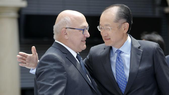 French Finance Minister Sapin talks to World Bank Group President Yong Kim before a family picture in Palace Chapel during the G7 finance ministers and central bankers meeting in Dresden
