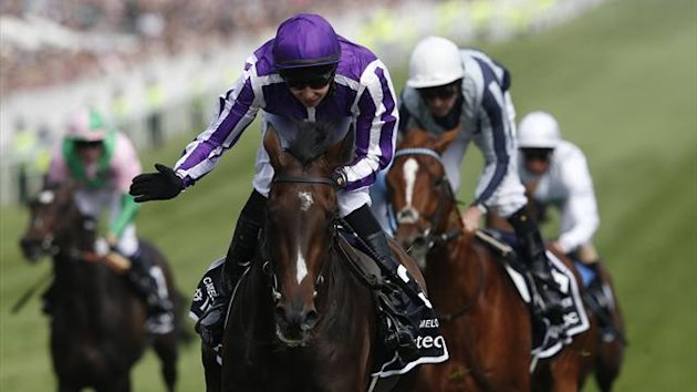 Camelot (C) ridden by Joseph O'Brien races for the finish line to win The Derby at the Epsom Derby festival in Epsom, southwest of London June 2, 2012. Queen Elizabeth gets four days of celebrations to mark her 60 years on the British throne under way on