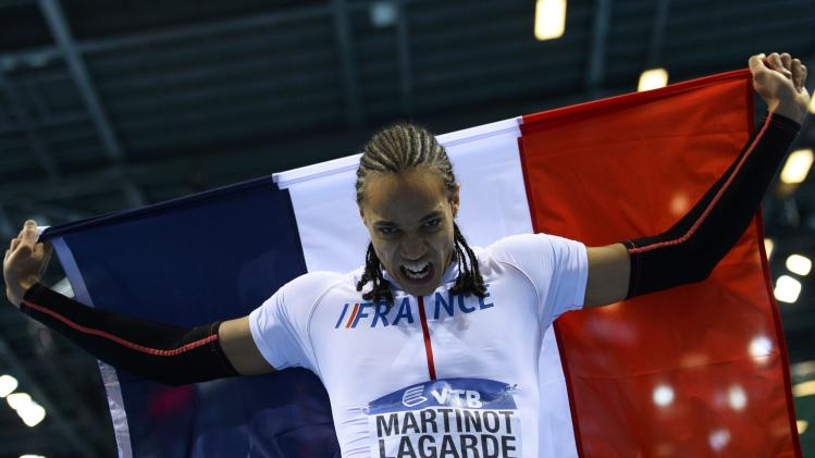 Second placed Martinot-Lagarde of France celebrates after the men's 60 metres hurdles final at the world indoor athletics championships at the ERGO Arena in Sopot