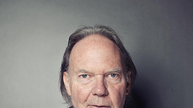 """This Sept. 27, 2012 photo shows singer-songwriter Neil Young posing for a portrait at The Carlyle hotel in New York. Young has released his first book, a memoir titled, """"Waging Heavy Peace."""" (Photo by Victoria Will/Invision/AP)"""