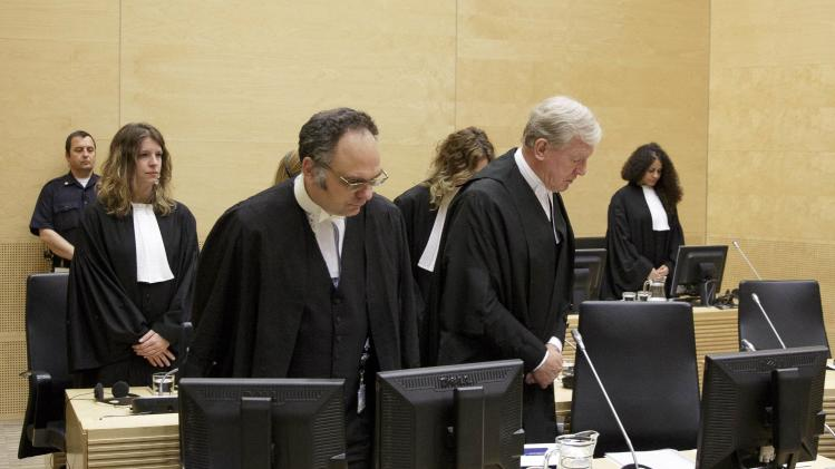 Defence counsel David Hooper and Andreas O'shea arrive in the courtroom during a trial against Congolese warlord Germain Katanga in the courtroom of the ICC in The Hague