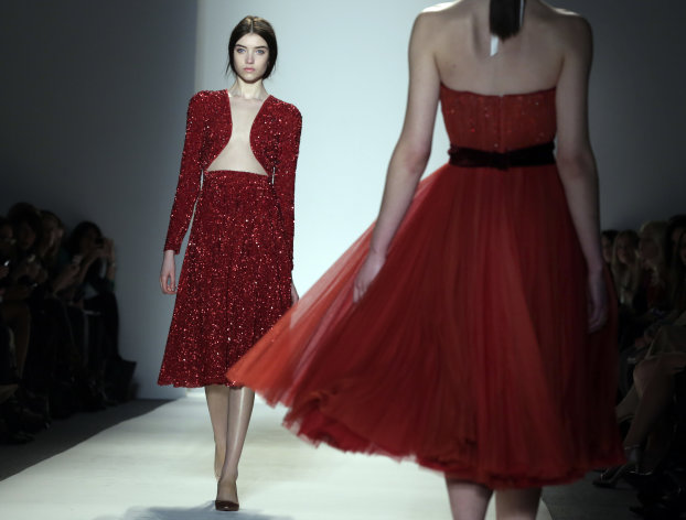 The Jenny Packham Fall 2013 collection is modeled during Fashion Week in New York on Tuesday, Feb. 12, 2013. (AP Photo/Richard Drew)