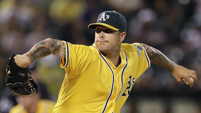 Oakland Athletics' Travis Blackley works against the Texas Rangers in the first inning of a baseball game, Tuesday, Oct. 2, 2012, in Oakland, Calif. (AP Photo/Ben Margot)
