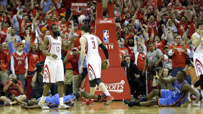 Oklahoma City Thunder's Serge Ibaka, left, and Reggie Jackson, right, lie on the ground as Houston Rockets' James Harden (13) and Omer Asik (3) celebrate after winning Game 4 in a first-round NBA basketball playoff series Monday, April 29, 2013, in Houston. The Rockets beat the Thunder 105-103. (AP Photo/David J. Phillip)