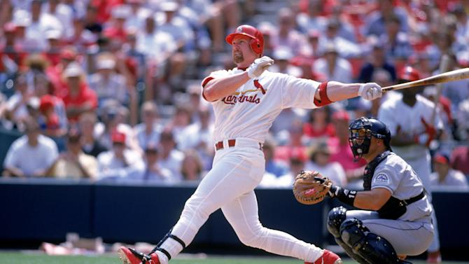 ST. LOUIS - UNDATED: Mark McGwire #25 of the St. Louis Cardinals watches the flight of the ball as he follows through on his swing during a game against the Colorado Rockies circa 1997-2001 at Busch Stadium in St. Louis, Missouri. (Photo by Ron Vesely/MLB Photos via Getty Images)