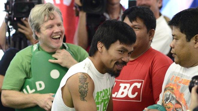 Freddie Roach (L) And Manny Pacquiao (R) Of The Philippinesprepare For A Media Workout At Wild Card Boxing Club On May AFP/Getty Images