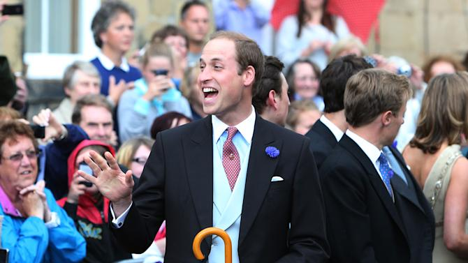 Britain's Prince William leaves after attending the wedding of the Duke and Duchess of Northumberland's daughter Lady Melissa Percy to chartered surveyor Thomas van Straubenzee at St Michael's Church in Alnwick, England, Saturday, June 22, 2013. (AP Photo/Scott Heppell)