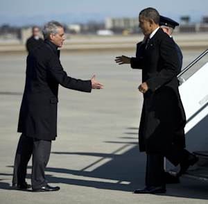"President Barack Obama, right, is greeted by Chicago Mayor Rahm Emanuel after arriving at Chicago O'Hare International Airport in Chicago, Friday, Feb. 15, 2013. The president Obama went to Chicago to pitch his ""Ladders of opportunity"" economic plan that he laid out in his State of the Union address.  (AP Photo/Evan Vucci)"