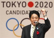 Japan's Prime Minister Shinzo Abe gestures as he speaks during Tokyo 2020 kick off rally in Tokyo in this August 23, 2013 file photograph. Tokyo defeated the bids from Madrid and Istanbul to win the right to host the 2020 summer Olympics. REUTERS/Yuya Shino/Files