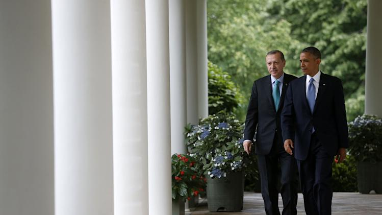 President Barack Obama and Turkish Prime Minister Recep Tayyip Erdogan walk to the Rose Garden of the White House in Washington, Thursday, May 16, 2013, for their joint news conference. (AP Photo/Charles Dharapak)