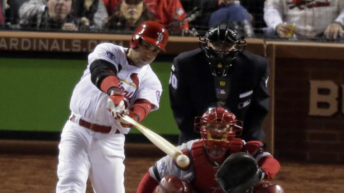 St. Louis Cardinals' Carlos Beltran hits a single during the third inning of Game 4 of baseball's World Series against the Boston Red Sox Sunday, Oct. 27, 2013, in St. Louis. (AP Photo/Charlie Riedel)