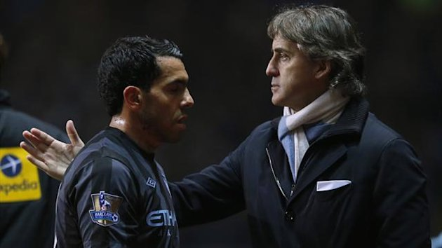 Manchester City manager Roberto Mancini congratulates Carlos Tevez as he is substituted during their English Premier League match against Aston Villa at Villa Park