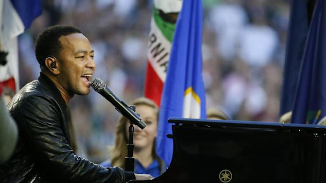 Singer John Legend performs America the Beautiful before the NFL Super Bowl XLIX football game between the Seattle Seahawks and the New England Patriots Sunday, Feb. 1, 2015, in Glendale, Ariz. (AP Photo/Matt York)