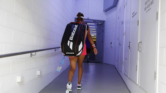Goerges of Germany walks off the court after being defeated by Makarova of Russia in their women's singles match at the Australian Open 2015 tennis tournament in Melbourne