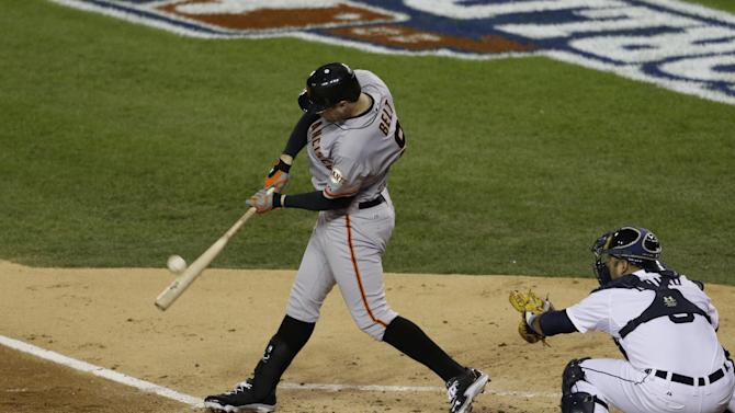 San Francisco Giants' Brandon Belt hits an RBI triple during the second inning of Game 4 of baseball's World Series against the Detroit Tigers Sunday, Oct. 28, 2012, in Detroit. (AP Photo/Patrick Semansky)