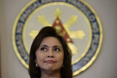 Philippines Vice President Leni Robredo listens to a reporter's question during a news conference following her resignation from her post in President Rodrigo Duterte's cabinet, at the Quezon City Reception House, Metro Manila