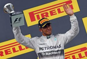 Third placed Mercedes Formula One driver Lewis Hamilton of Britain celebrates after the Hungarian F1 Grand Prix at the Hungaroring circuit, near Budapest