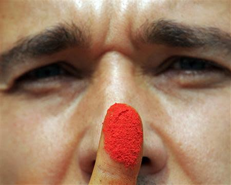Paprika maker Szabo shows his pepper-stained finger in Batya