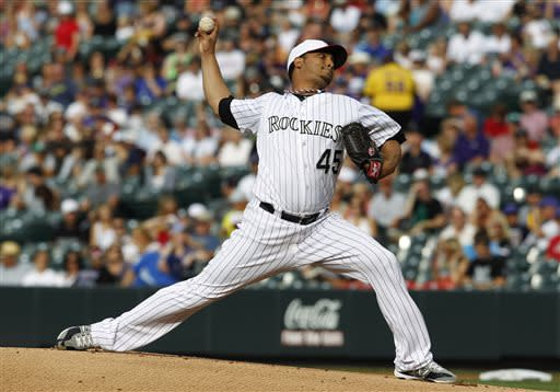 Cuddyer leads Rockies to 9-5 win over Dodgers