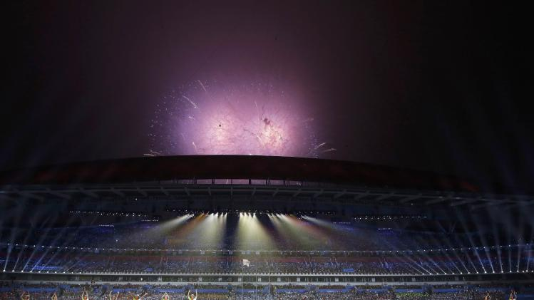 Fireworks ignite in the sky during the closing ceremony of the 2014 Nanjing Youth Olympic Games in Nanjing