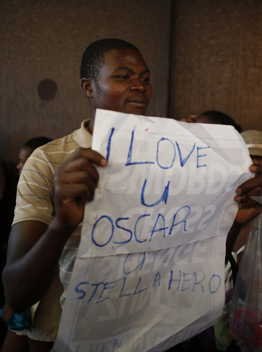 A supporter of Oscar Pistorius celebrates outside the Pretoria Magistrates court