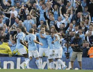 Manchester City's Sergio Aguero (16) celebrates with teamates after scoring against Manchester United during their English Premier League soccer match at The Etihad Stadium in Manchester, northern England