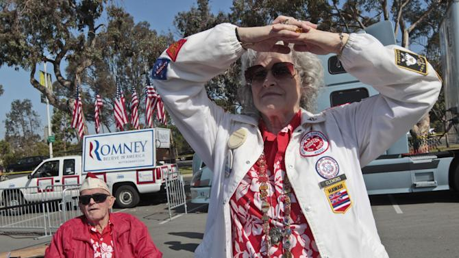 David and Cynthea Brown, of San Diego, wait for the start of a campaign event with Republican presidential candidate, former Massachusetts Gov. Mitt Romney, and Sen. John McCain, R-Ariz., at the Veterans Museum & Memorial Center, Monday, May 28, 2012 in San Diego.  (AP Photo/Mary Altaffer)