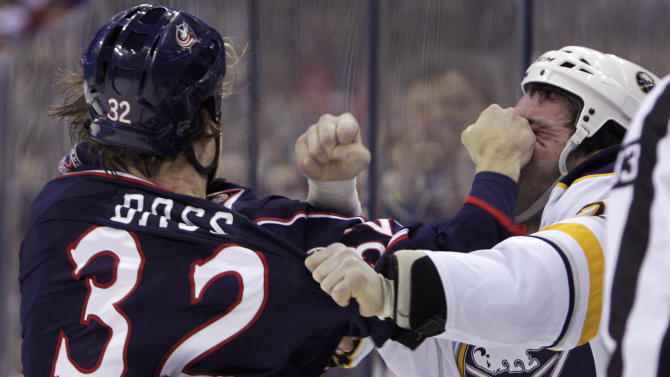 Columbus Blue Jackets' Cody Bass, left, and Buffalo Sabres' Zenon Konopka fight during the first period of an NHL hockey game, Saturday, Jan. 25, 2014, in Columbus, Ohio. (AP Photo/Jay LaPrete)