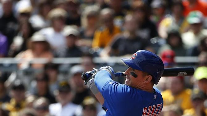 Chicago Cubs' John Baker (12) drives in a run with a sacrifice fly to left field during the second inning of a baseball game against the Pittsburgh Pirates in Pittsburgh Sunday, Sept. 14, 2014. (AP Photo/Gene J. Puskar)