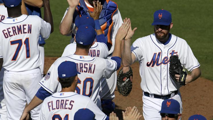 New York Mets relief pitcher Bobby Parnell, right, celebrates with teammates after beating the Washington Nationals 5-3 in an exhibition spring training baseball game in Port St. Lucie, Fla., Saturday, Feb. 23, 2013. The Mets won 5-3. (AP Photo/Julio Cortez)