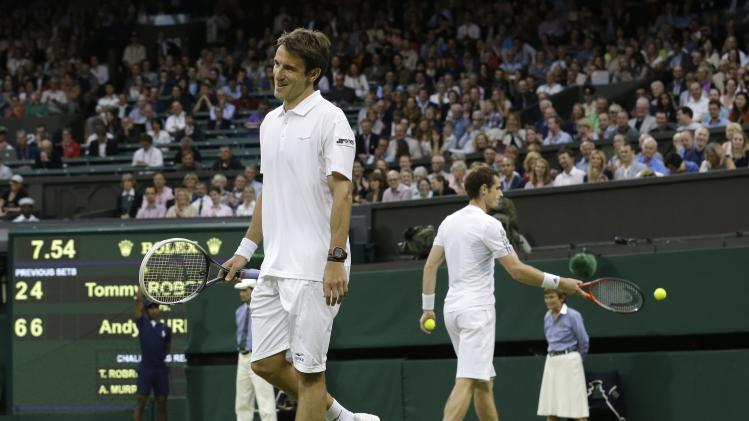 Tommy Robredo of Spain, left, grimaces after losing a point to Andy Murray of Britain during their Men's singles match at the All England Lawn Tennis Championships in Wimbledon, London, Friday, June 28, 2013. (AP Photo/Anja Niedringhaus)
