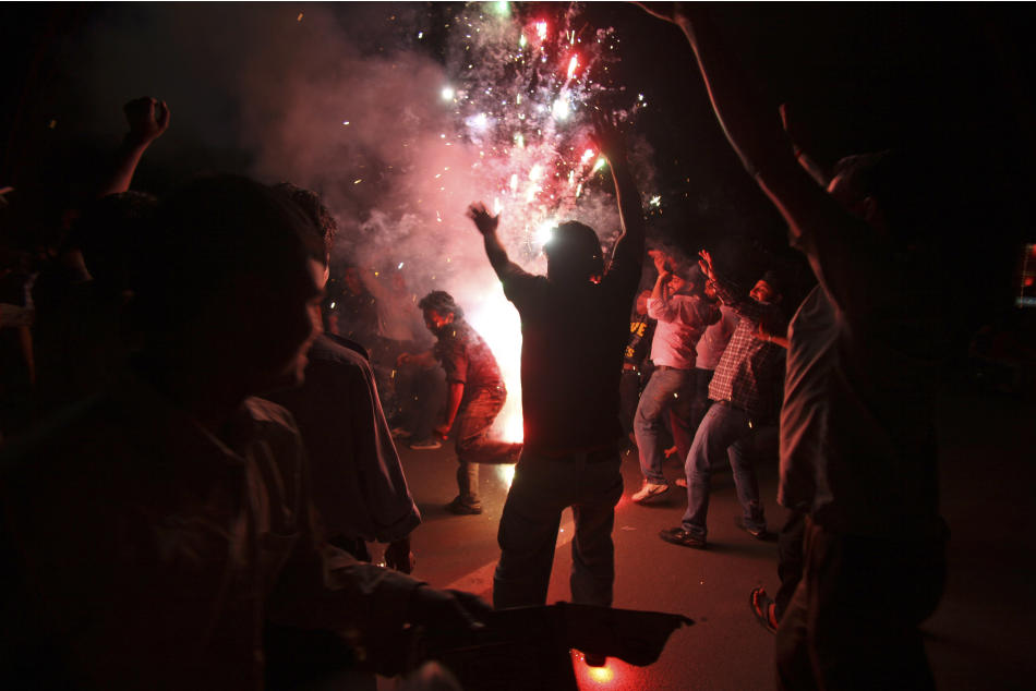 Indian cricket fans celebrate their team's victory over Sri Lanka to win the Cricket World Cup final, in Jammu, India, Saturday, April 2, 2011. (AP Photo/Channi Anand)