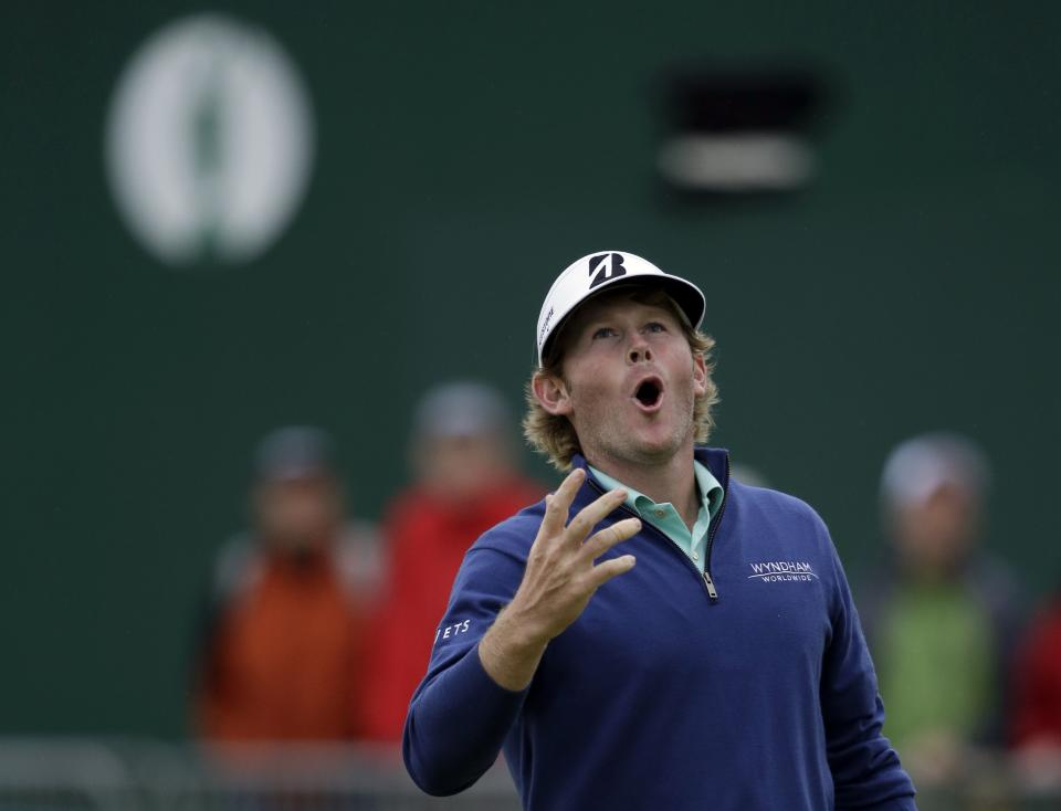 Brandt Snedeker of the United States reacts after missing a birdie putt on the 18th green at Royal Lytham & St Annes golf club during the first round of the British Open Golf Championship, Lytham St Annes, England, Thursday, July 19, 2012. (AP Photo/Tim Hales)