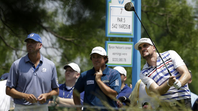 Matt Kuchar, from left, Jason Dufner, center, and Keegan Bradley, right, all watch Bradley's shot off the seventh tee during the second round of the Byron Nelson Championship golf tournament, Friday, May 17, 2013, in Irving, Texas. Bradley ended the day at 11 under par for the tournament. (AP Photo/Tony Gutierrez)