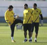 FC Barcelona's Lionel Messi of Argentina, left, clowns around with his teammates during the team's training in Yokohama, near Tokyo, Monday, Dec. 12, 2011. Barcelona will play the semi-final match in the Club World Cup on Dec. 15. (AP Photo/Junji Kurokawa)