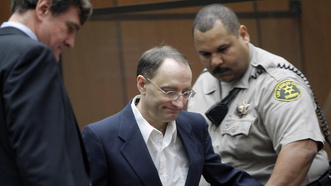 Christian Karl Gerhartsreiter, center, with his attorney Bradford Bailey, left arrives for opening statements in his trial, in Los Angeles Criminal Court Building Monday, March 18, 2013. A prosecutor told jurors Monday he will prove a cold-case murder allegation against the German immigrant who spent years moving through U.S. society under a series of aliases, most notoriously posing as a member of the fabled Rockefeller family. He has pleaded not guilty to the killing of John Sohus, 27, who disappeared with his wife, Linda, in 1985 while Gerhartsreiter, using an alias, was a guest cottage tenant at the home of Sohus' mother, where the couple lived.(AP Photo/Nick Ut )