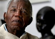 FILE - Chinua Achebe, Nigerian-born novelist and poet poses his life at his home on the campus of Bard College in Annandale-on-Hudson, New York where he is a professor in this Jan. 22, 2008 file photo. Achebe, who wrote the classic &quot;Things Fall Apart,&quot; has died. He was 82. Achebe&#39;s publisher confirmed his death Friday, March 22, 2013. (AP Photo/Craig Ruttle, File)