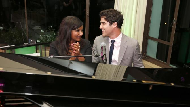 IMAGE DISTRIBUTED FOR FOX - Darren Criss performs for Mindy Kaling, left, at VERTE Grades of Green's annual fundraising event to benefit environmental education at Bel-Air Bay Club on April 11, 2013 in Pacific Palisades, California. (Photo by Todd Williamson/Invision for Fox/AP Images)