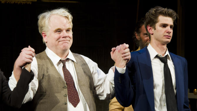 """FILE - In this March 15, 2012 file photo, actors Philip Seymour Hoffman, left, and Andrew Garfield appear at the curtain call for the opening night performance of the Broadway revival of Arthur Miller's """"Death of A Salesman"""" in New York.  The production revealed May 16, 2012, that it will recoup its $3.1 million capitalization this week. The show, which has netted seven Tony Award nominations, stars Philip Seymour Hoffman and Andrew Garfield. (AP Photo/Charles Sykes, File)"""