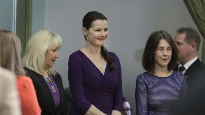 "Actress Geena Davis, center, smiles a she waits to be escorted into the Assembly by Assembly Minority Leader Connie Conway, R-Tulare, left, and Assemblywoman Nancy Skinner, D-Berkeley, at the Capitol in Sacramento, Calif., Monday, March 4, 2013. Davis says remarks ""containing disrespect for women"" from the host of last month's Academy Awards ceremony overshadowed the win of an animated film with a strong female character. (AP Photo/Rich Pedroncelli)"