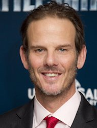 FILE - In this March 28, 2012 file photo, director Peter Berg poses for photographs at a central London hotel for the photo call of &quot;Battleship.&quot; Berg, who created TV&#39;s Friday Night Lights, is accusing Mitt Romney of plagiarizing a phrase from the show to use as a campaign slogan. (AP Photo/Joel Ryan, Fie)