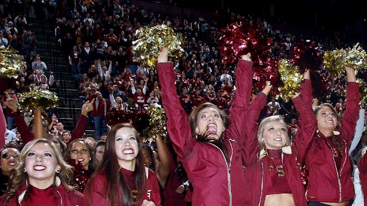 Florida State Golden Girls cheerleaders react as they watch Florida State score a touchdown on a 30-foot screen at the Tallahassee Leon County Civic Center in the second quarter of the NCAA BCS National Championship college football game against Auburn, Monday, Jan. 6, 2014, in Tallahassee, Fla. (AP Photo/Phil Sears)