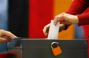 A voter casts his ballot at a polling station during…