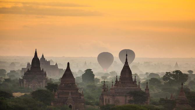 This December 2012 photo shows agriculture and a few of the over 2200 Pagodas found in Bagan, Myanmar. (AP Photo/Richard Camp)