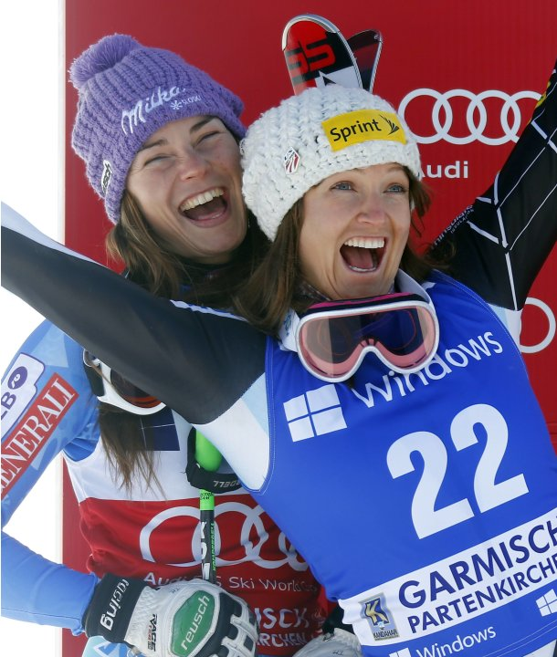 Slovenia's Maze and Mancuso from the U.S. pose on the podium after the women's Alpine Skiing World Cup super-G race in Garmisch-Partenkirchen