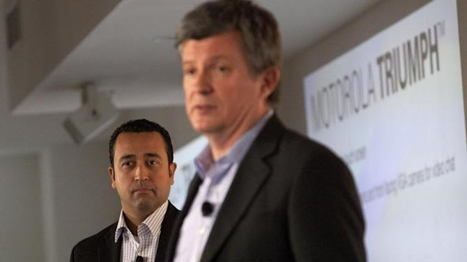 Product Chief at Sprint, Adib watches on as Motorola Senior Vice President of Product Development, Mutricy speaks at a product launch in New York